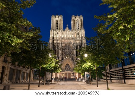 Famous Notre-Dame de Reims at twilight - stock photo