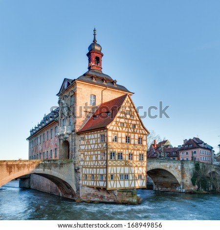 Famous Old City Hall of Bamberg on the river Regnitz in the morning hours in Bavaria / Germany. Picture was taken at sunrise - stock photo