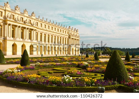 Famous palace Versailles near Paris, France with beautiful gardens - stock photo