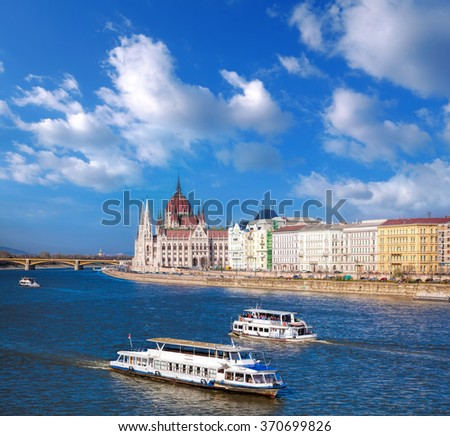Famous Parliament with boats on Danube river in Budapest, Hungary - stock photo