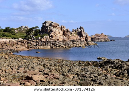 Famous Pink Granite Coast (cote de granite rose in french) at low tide of Ploumanach, village in the commune of Perros-Guirec in France - stock photo