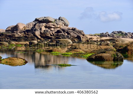 Famous Pink Granite Coast (cote de granite rose in french) of peninsula Renote at Tregastel, commune in the Cotes of Armor department of the region of Brittany in northwestern France - stock photo