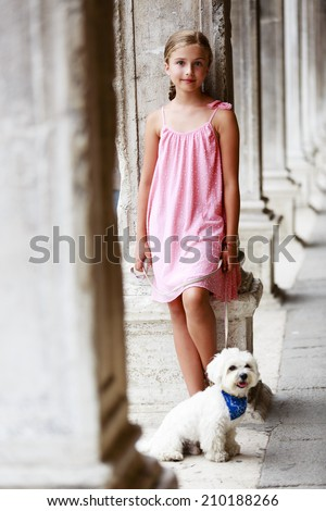 Famous places in Europe, Portrait of fashion girl with dog - Italy, Venice - stock photo