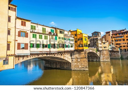 Famous Ponte Vecchio with river Arno at sunset in Florence, Italy - stock photo