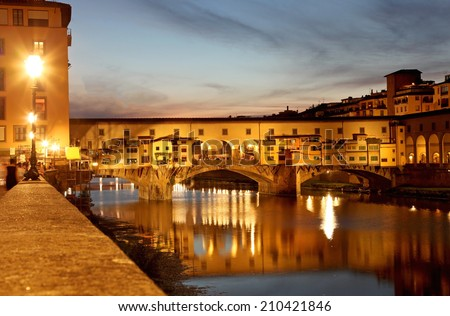 Famous Ponte Vecchio with river Arno at sunset in Florence, Tuscany, Italy - stock photo