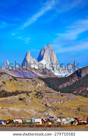 Famous rock Fitz Roy peaks in the Andes. Magnificent panorama of snow-capped mountains in Patagonia. At the foot of the mountains is a small tourist village of El Chalten - stock photo