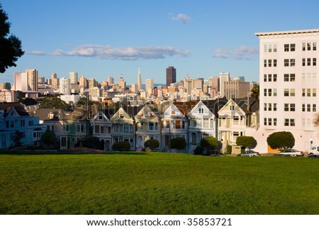 Famous Row of Houses in San Francisco at sunset - stock photo