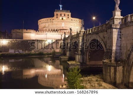 Famous Saint Angel castle and bridge over Tiber river in Rome, Italy - stock photo