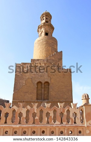 Famous spiral minaret of Ibn Tulun Mosque in Cairo - stock photo