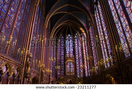 Famous stained glass windows and ceiling within La Sainte-Chapelle Chapel in Paris, France - stock photo