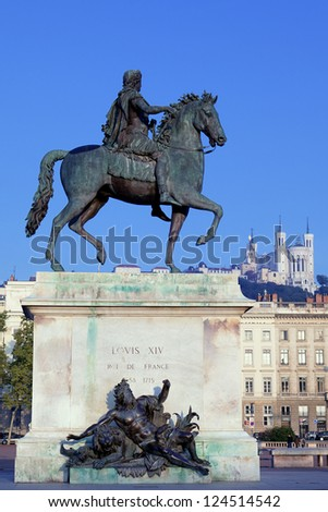 famous statue of Louis and Fourviere basilic on a background - stock photo