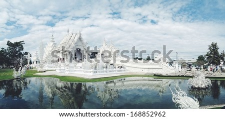Famous Thailand temple or grand white church Call Wat Rong Khun, at Chiang Rai province, northern Thailand - stock photo