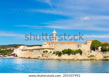 Famous touristic Krk town on Krk island, Croatia, Europe. Krk is a Croatian island in the northern Adriatic Sea, located near Rijeka in the Bay of Kvarner and part of Primorje Gorski Kotar county. - stock photo