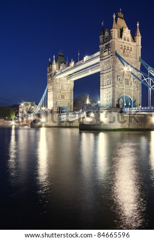 Famous Tower Bridge in London at dusk - Thames river on foreground - stock photo