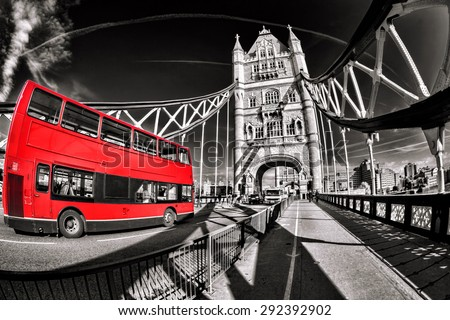 Famous Tower Bridge with red bus in London, England