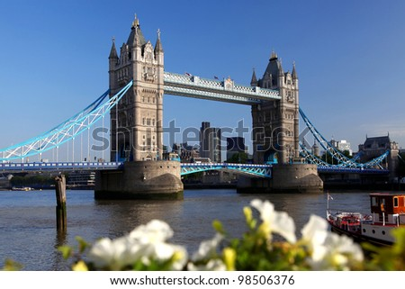 Famous Tower Bridge with spring flowers in London, UK - stock photo