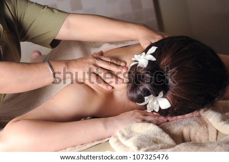 Famous traditional Shiatsu body massaging, part of spa treatment (shallow depth of field) - stock photo