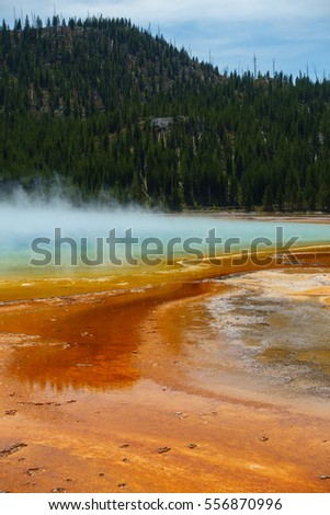 Famous trail of Grand Prismatic Springs in Yellowstone National Park. Beautiful  hot springs with vivid color in Wyoming.