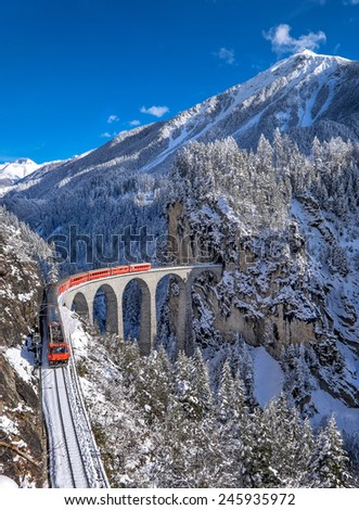 Famous Train with Jungfrau Mountain on Sunny Day - stock photo