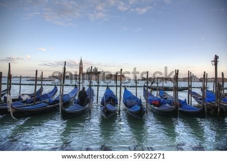 Famous Venice gondola at sunset - stock photo