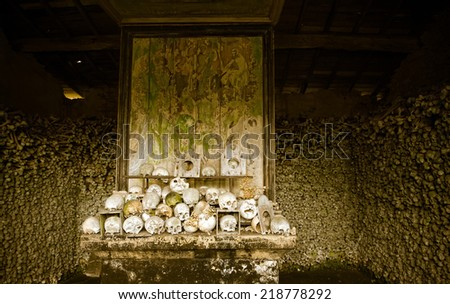 Famous view inside the ossuary of Marville, France, with thousands of ancient skulls of 19th century and older - stock photo
