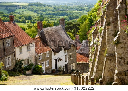 Famous view of Picturesque cottages on cobbled street at Gold Hill, Shaftesbury Dorset England UK Europe - stock photo