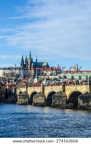 famous view of the prague castle and the charles bridge in prague which every year attracts millions of tourists from all around the world.