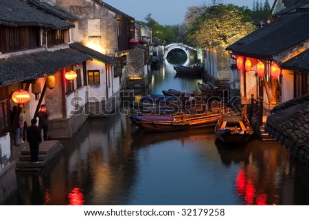 Famous water village Zhouzhuang in Jiangsu ,China. The houses  by the river are built several hundred years ago with 	a typical architectural style of the Ming and Qing Dynasties - stock photo