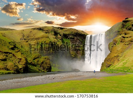 famous waterfall Skogafoss in Iceland at sunset - stock photo
