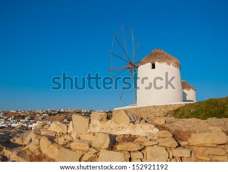 Famous windmill of Mykonos  at sunset - stock photo