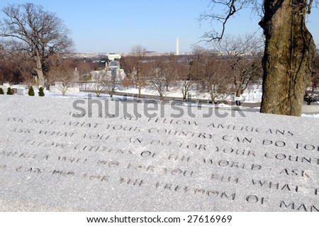 Famous words of President John F. Kennedy at the Arlington National Cemetery in Virginia, with the Washington Monument in the background. - stock photo