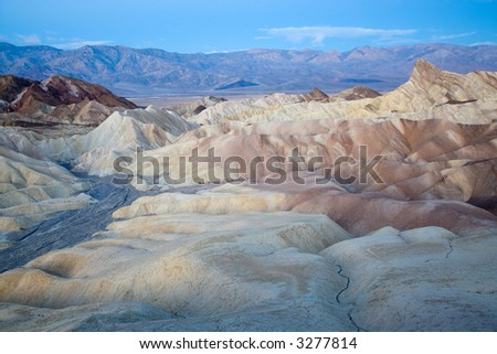Famous Zabriskie Point in Death Valley just before sunrise. - stock photo