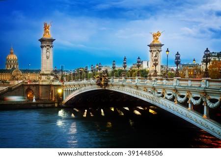 famouse Alexandre III Bridge at night,  Paris, France, retro toned - stock photo