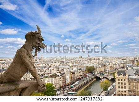 famouse Gargoyle on Notre Dame Cathedral and city of  Paris, France