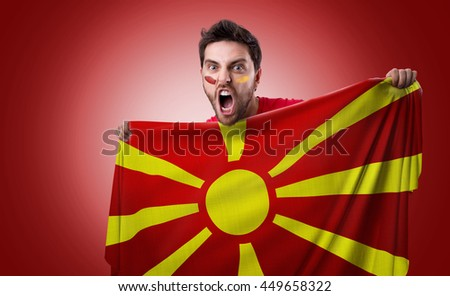 Fan holding the flag of Macedonia