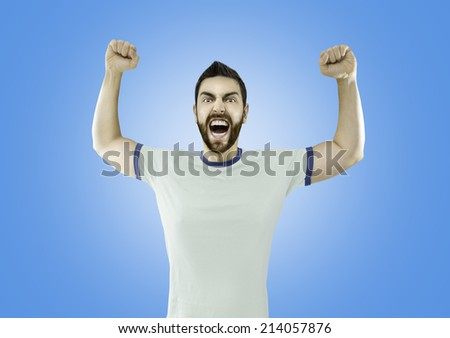Fan in white and blue t-shirt celebrates on blue background