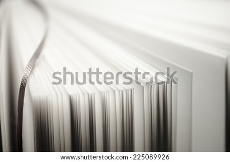 fan of book pages making texxture/background - stock photo