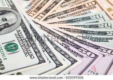 Fan of dollar paper money; many dollar banknotes