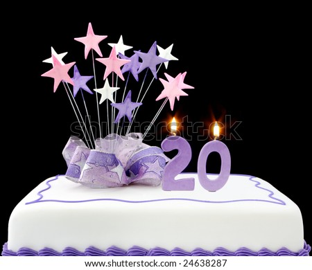 Fancy cake with number 20 candles.  Decorated with ribbons and star-shapes, in pastel tones. - stock photo