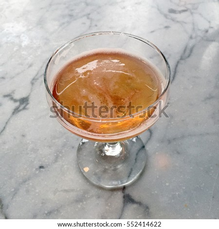 Fancy champagne coupe or flute on marble table top