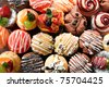 Fancy color of muffins display and variety of topping - stock photo