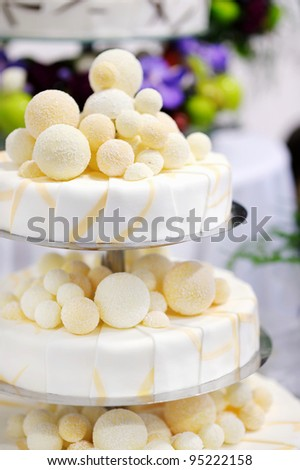 Fancy delicious white and yellow wedding cake - stock photo