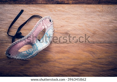 Fancy mask is placed on a wooden floor - stock photo