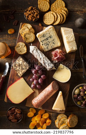Fancy Meat and Cheeseboard with Fruit as an Appetizer - stock photo