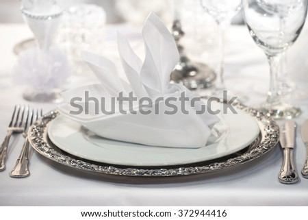 Fancy table set for a wedding party event on a table - stock photo