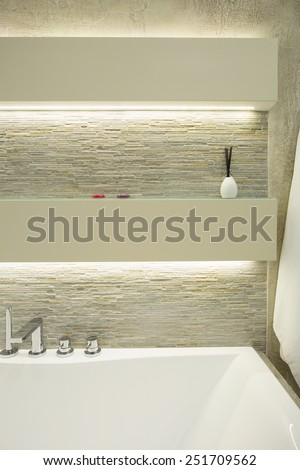 Fancy wall above the white bath in modern bathroom - stock photo