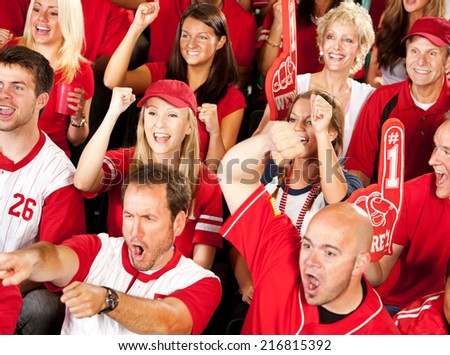 Fans: Baseball Fans Cheer When Team Gets A Hit - stock photo