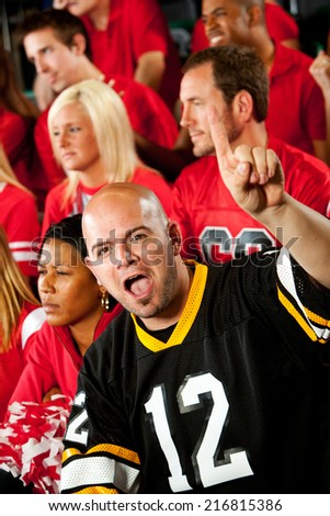 Fans: Fan From Opposing City Cheers For His Team - stock photo
