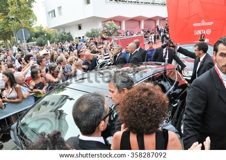 Fans waiting for the arrival by car from George Clooney in the Festival of the Cinema. Venice 2011 - stock photo
