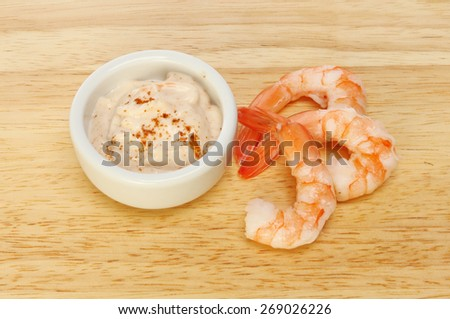 Fantail prawns with seafood sauce on a wooden board - stock photo